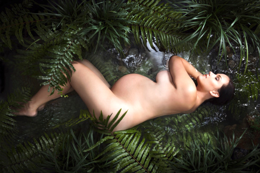 168583822-nude-pregnant-woman-sleeping-in-rainforest-gettyimages